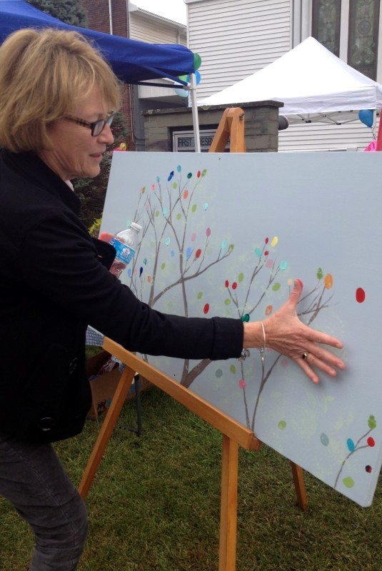 Assemblywoman Gunther adding to the Community Art Project